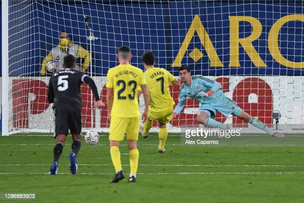 Gerard Moreno of Villarreal scores a penalty for his team's first goal past Thibaut Courtois of Real Madrid during the La Liga Santander match...