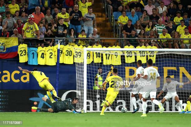 Gerard Moreno of Villarreal scores his sides first goal during the Liga match between Villarreal CF and Real Madrid CF at Estadio de la Ceramica on...