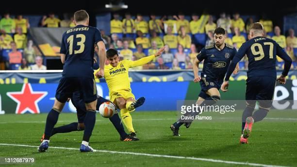 Gerard Moreno of Villarreal scores their team's second goal during the UEFA Europa League Quarter Final Second Leg match between Villarreal and...