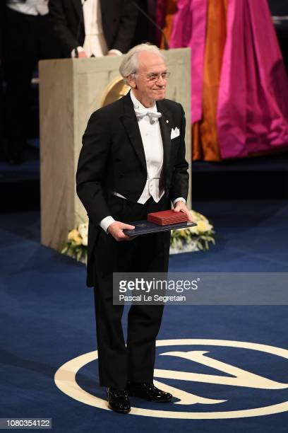 Gerard Mourou laureate of the Nobel Prize in Physics acknowledges applause after he received his Nobel Prize from King Carl XVI Gustaf of Sweden...