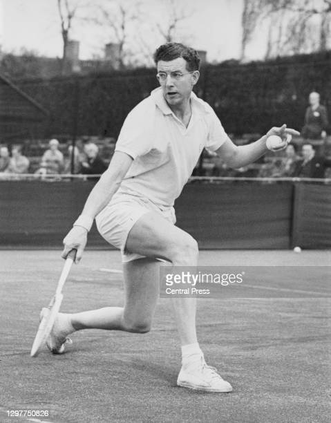 Gerard Oakley of Great Britain makes a backhand return to WJ King during their Men's Singles match at the Surrey Hard Court Championships on 1st...