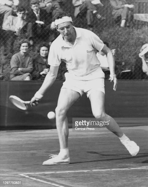Gerard Oakley of Great Britain makes a forehand return to John Maloney of South Africa during their Men's Singles Final match at the Surrey Hard...
