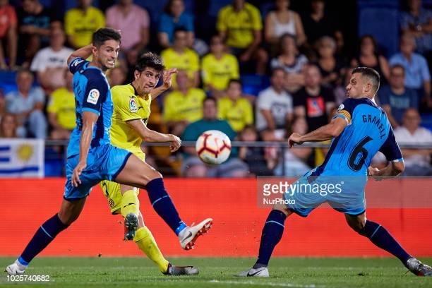 Gerard of Villarreal CF kicks the ball next to Juan Pedro Ramirez Lopez Juanpe and Alex Granell Nogue of Girona FC during the La Liga match between...