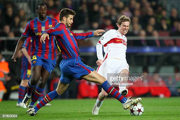 Gerard Piqué of Barcelona challenges for the ball with Aliaksandr Hleb of Stuttgart during the UEFA Champions League round of sixteen second leg...
