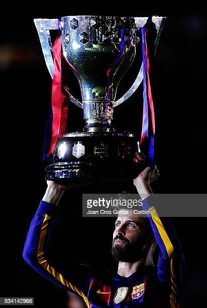 Gerard Piqué of FCBarcelona lifting up the Cup during the Spanish League and 'Copa del Rey' trophys celebration May 23 2016 in Barcelona Spain