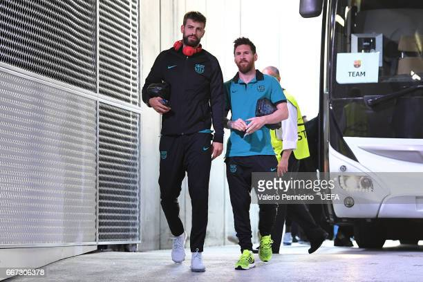 Gerard Pique and Lionel Messi of FC Barcelona arrive at his dressing room ahead of the the UEFA Champions League Quarter Final first leg match...