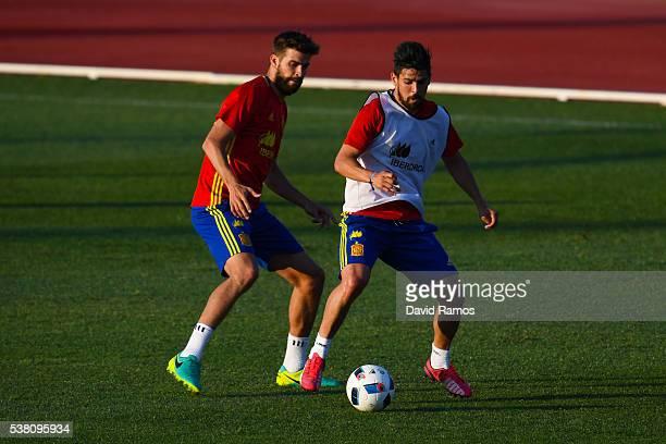 Gerard Pique and Manuel Agudo 'Nolito' of Spain of Spain in action during a training session at La Ciudad Del Futbol de las Rozas on June 4 2016 in...