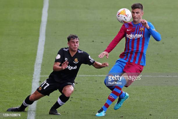 Gerard Pique and Prats during the friendly match between FC Barcelona and Club Gimnastic de Tarragona, played at the Johan Cruyff Stadium on 21th...