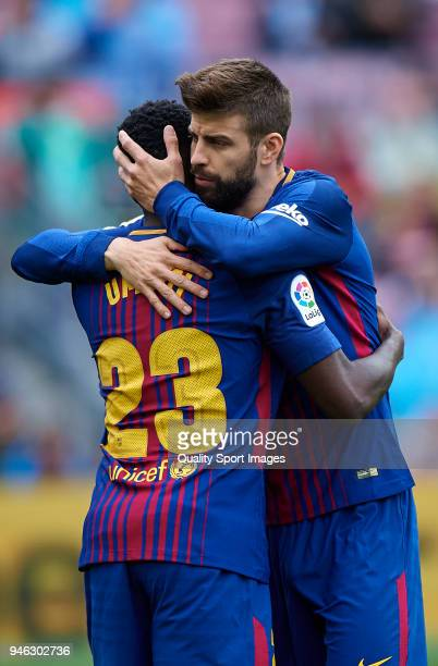 Gerard Pique and Samuel Umtiti of Barcelona congrats each other during the La Liga match between Barcelona and Valencia at Camp Nou on April 14 2018...