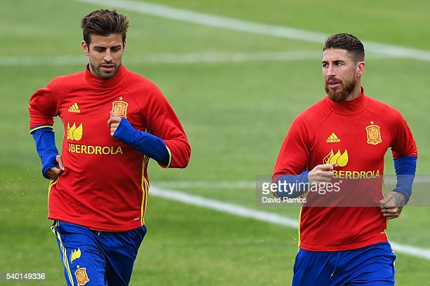 Gerard Pique and Sergio Ramos of Spain warm up during a training session on June 14 2016 in La Rochelle France