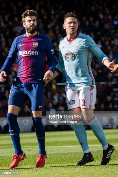Gerard Pique Bernabeu of FC Barcelona fights for position with Andreu Fontas Prat of RC Celta de Vigo during the La Liga 201718 match between FC...