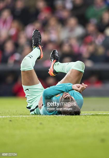 Gerard Pique Bernabeu of FC Barcelona lies injured on the pitch during their Copa del Rey Round of 16 first leg match between Athletic Club and FC...