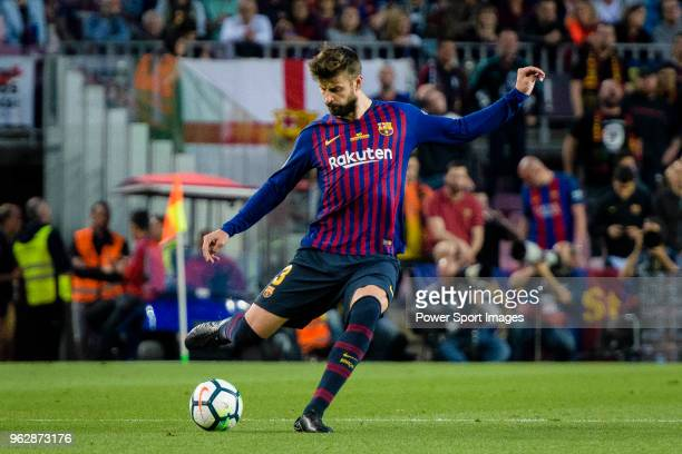 Gerard Pique Bernabeu of FC Barcelona looks to bring the ball down during the La Liga match between Barcelona and Real Sociedad at Camp Nou on May 20...