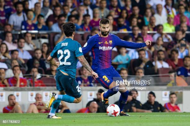Gerard Pique Bernabeu of FC Barcelona plays against Isco Alarcon of Real Madrid during the Supercopa de Espana Final 1st Leg match between FC...