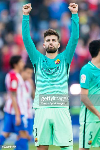 Gerard Pique Bernabeu of FC Barcelona reacts during their La Liga match between Atletico de Madrid and FC Barcelona at the Santiago Bernabeu Stadium...