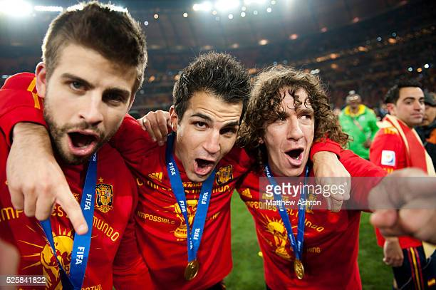 Gerard Pique Cesc Fabregas and Carles Puyol of Spain celebrate after a 01 victory over the Netherlands and winning the 2010 FIFA World Cup South...