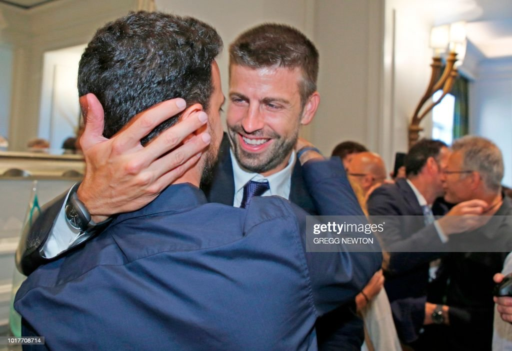 Gerard Pique, Founder of the Kosmos sports group and Barcelona FC soccer player celebrates with team members after the Davis Cup vote at the ITF annual general meeting in Orlando, Florida on August 16, 2018. - World tennis chiefs on approved a radical Davis Cup revamp that will overhaul the 118-year-old competition, condensing the annual worldwide showpiece into an 18-team, week-long event. ITF president David Haggerty supported the revamp proposed by Kosmos, a group led by Barcelona football star Gerard Pique -- who flew in from Spain for the vote -- and backed by Japanese billionaire Hiroshi Mikitani, that has vowed $3 billion over 25 years to support the new event.
