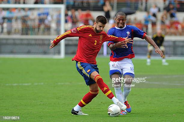 Gerard Pique from Spain fights for the ball with Hector Ramos of Puerto Rico during a friendly match between Puerto Rico and Spain at Juan Ramón...