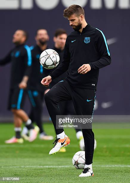Gerard Pique juggles the ball during a Barcelona training session ahead of their UEFA Champions League quarter final first leg match against Atletico...