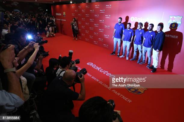 Gerard Pique Lionel Messi Neymar Arda Turan and Rakuten CEO Hiroshi Mikitani pose for photographs with the new uniforms during the FC Barcelona And...
