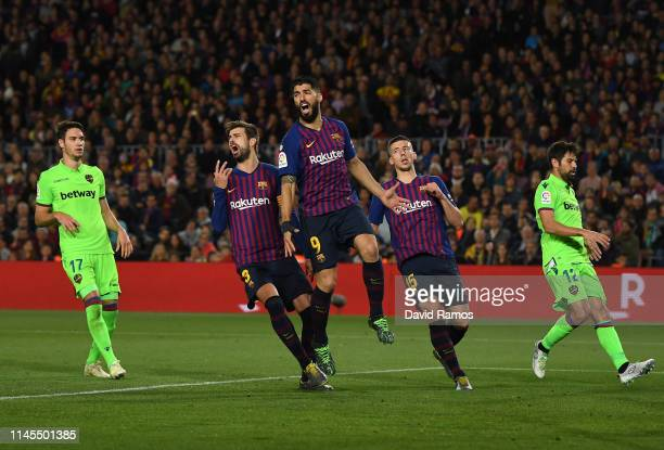 Gerard Pique Luis Suarez and Clement Lenglet of FC Barcelona react during the La Liga match between FC Barcelona and Levante UD at Camp Nou on April...