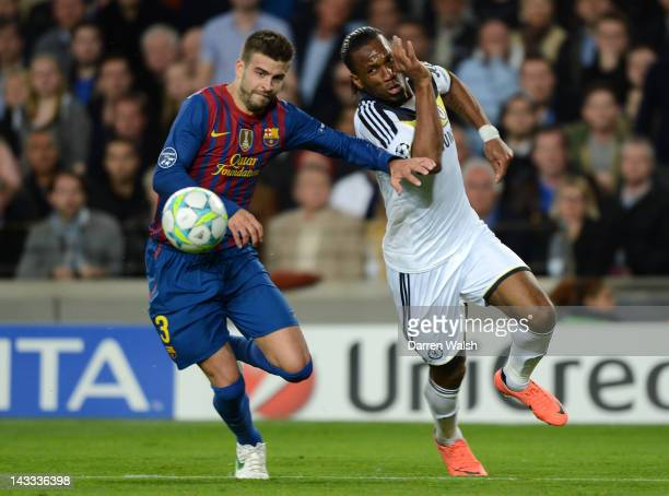 Gerard Pique of Barcelona and Didier Drogba battle for the ball during the UEFA Champions League Semi Final, second leg match between FC Barcelona...