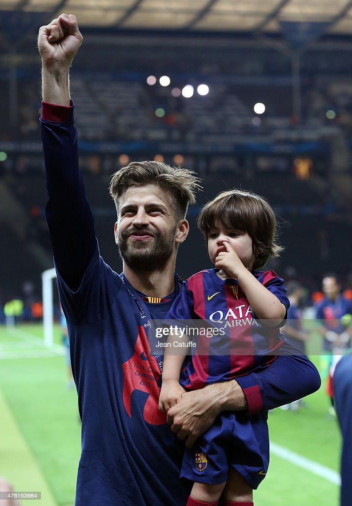 Gerard Pique of Barcelona and his son Milan Pique Mebarak celebrate the victory after the UEFA Champions League Final between Juventus Turin and FC Barcelona at Olympiastadion on June 6, 2015 in Berlin, Germany.