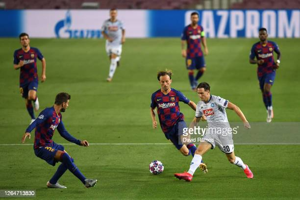 Gerard Pique of Barcelona and Ivan Rakitic of Barcelona battles for possession with Piotr Zielinski of SSC Napoli during the UEFA Champions League...