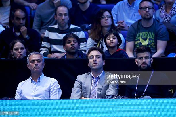 Gerard Pique of Barcelona and Jose Mourinho manager of Manchester United watch the men's single match between Novak Djokovic of Serbia and Dominic...