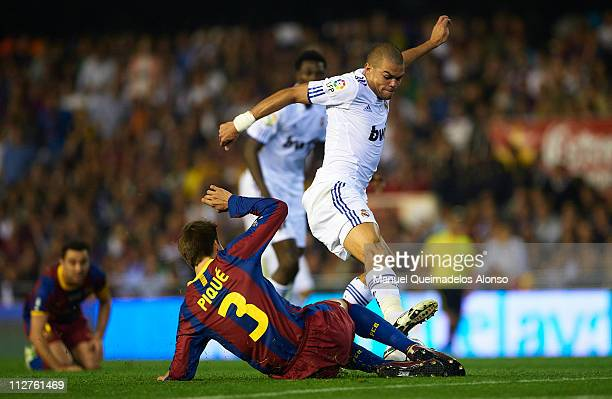 Gerard Pique of Barcelona and Pepe of Real Madrid competes for the ball during the Copa del Rey final match between Real Madrid and Barcelona at...