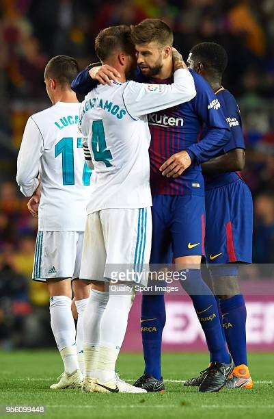 Gerard Pique of Barcelona and Sergio Ramos of Real Madrid embrace after the La Liga match between Barcelona and Real Madrid at Camp Nou on May 6 2018...