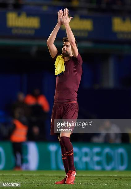 Gerard Pique of Barcelona applauds the fans after the La Liga match between Villarreal and Barcelona at Estadio La Ceramica on December 10 2017 in...