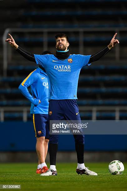 Gerard Pique of Barcelona celebrates after hitting the crossbar in an unofficial crossbar challenge during a Barcelona training session at the FIFA...