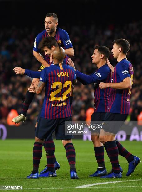 Gerard Pique of Barcelona celebrates after scoring his team's first goal with Jordi Alba and team mates during the La Liga match between FC Barcelona...