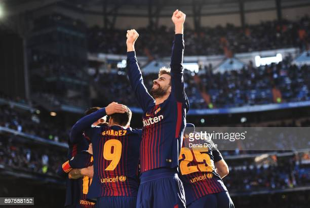 Gerard Pique of Barcelona celebrates his sides third goal during the La Liga match between Real Madrid and Barcelona at Estadio Santiago Bernabeu on...