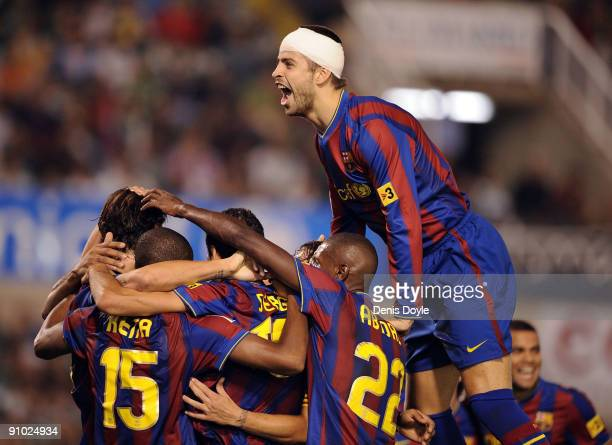 Gerard Pique of Barcelona celebrates his team's first goal against Racing Santander during the La Liga match between Racing Santander and Barcelona...
