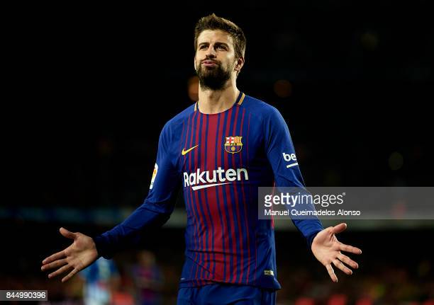 Gerard Pique of Barcelona celebrates scoring his team's fourth goal during the La Liga match between Barcelona and Espanyol at Camp Nou on September...