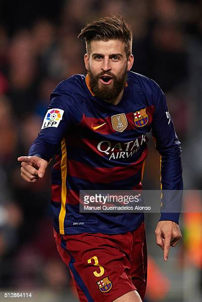 Gerard Pique of Barcelona celebrates scoring his team's second goal during the La Liga match between FC Barcelona and Sevilla FC at Camp Nou on...