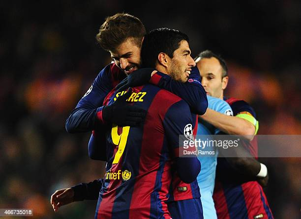 Gerard Pique of Barcelona celebrates victory with Luis Suarez of Barcelona after the UEFA Champions League Round of 16 second leg match between...