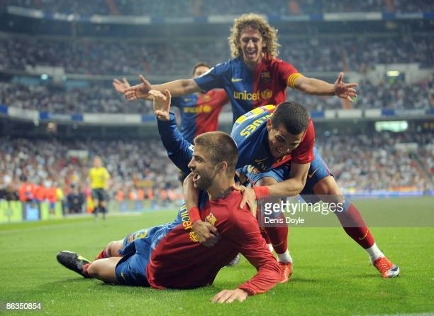 Gerard Pique of Barcelona celebrates with Dani Alves and Carles Puyol after scoring Barcelona's sixth goal during the La Liga match between Real...