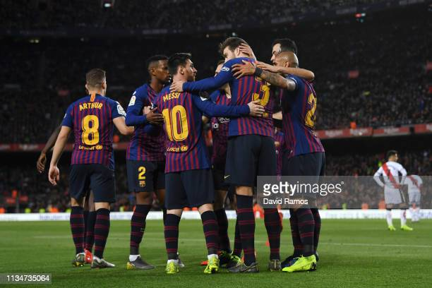 Gerard Pique of Barcelona celebrates with teammates after scoring his team's first goal during the La Liga match between FC Barcelona and Rayo...
