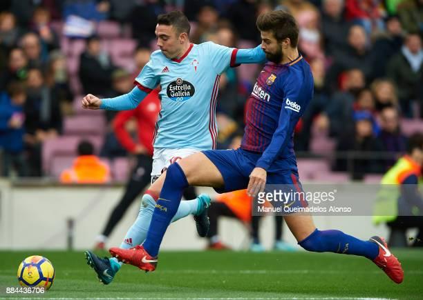 Gerard Pique of Barcelona competes for the ball with Iago Aspas of Celta during the La Liga match between Barcelona and Celta de Vigo at Camp Nou on...