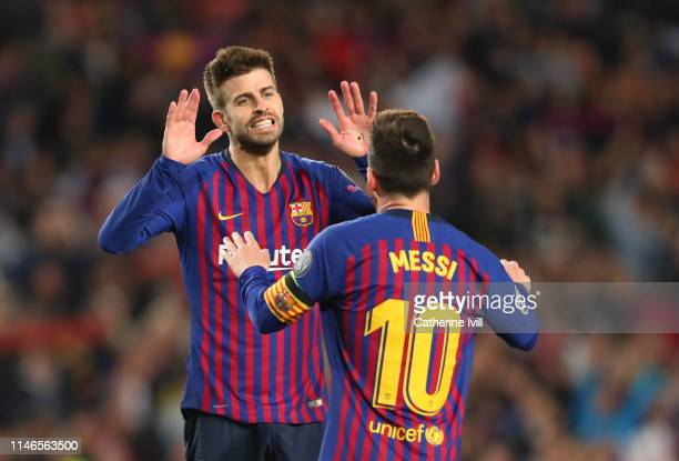 Gerard Pique of Barcelona congratulates Lionel Messi during the UEFA Champions League Semi Final first leg match between Barcelona and Liverpool at...