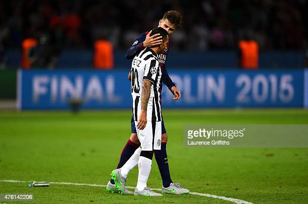 Gerard Pique of Barcelona consoles Carlos Tevez of Juventus after the UEFA Champions League Final between Juventus and FC Barcelona at Olympiastadion...