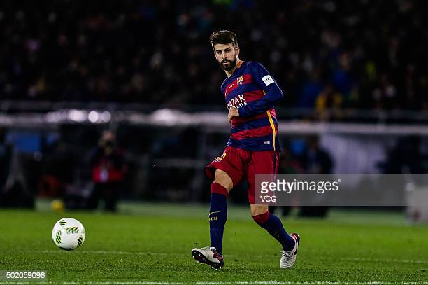 Gerard Pique of Barcelona drives the ball during the FIFA Club World Cup Final Match between FC Barcelona and River Plate at International Stadium...
