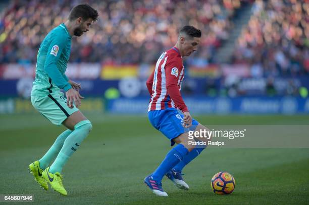 Gerard Pique of Barcelona fights for the ball with Fernando Torres of Atletico de Madrid during the La Liga match between Atletico Madrid and FC...