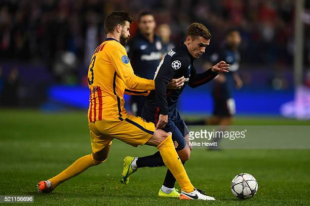 Gerard Pique of Barcelona fouls Antoine Griezmann of Atletico Madrid during the UEFA Champions League Quarter Final Second Leg between Club Atletico...