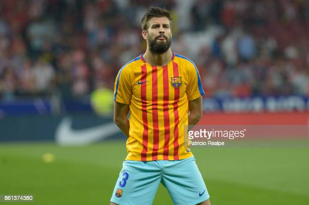 Gerard Pique of Barcelona gestures before the match between Atletico Madrid and Barcelona as part of La Liga at Wanda Metropolitano Stadium on...