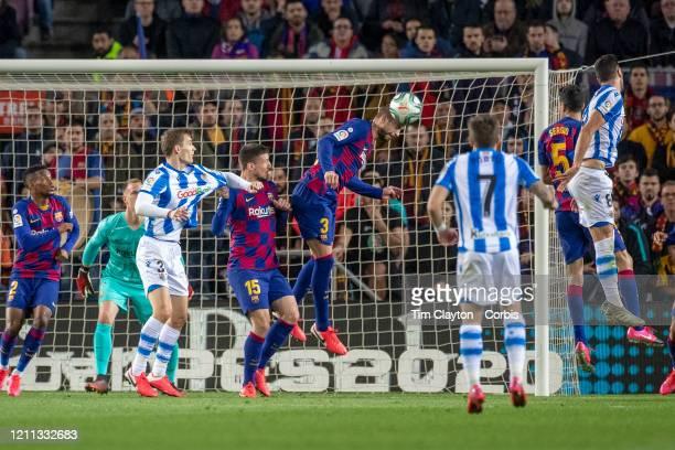 Gerard Pique of Barcelona heads clear during the Barcelona V Real Sociedad La Liga regular season match at Estadio Camp Nou on March 7th 2020 in...