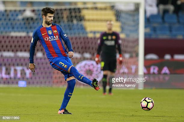 Gerard Pique of Barcelona in action during a friendly soccer match between Al-Ahli Saudi and Barcelona at Al-Gharrafa Stadium in Doha, Qatar on...